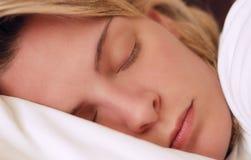 Beautiful young woman sleeping Stock Photography