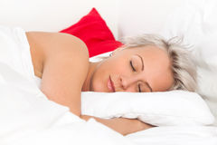 Beautiful young woman sleeping in bed Stock Photo