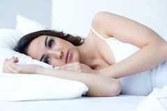 Beautiful young woman sleeping in the bed. Stock Image