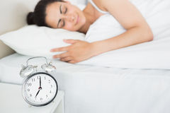 Beautiful young woman sleeping in bed Royalty Free Stock Photo