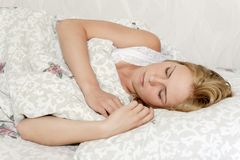 Beautiful young woman sleeping in bed Royalty Free Stock Images