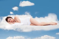 Young Woman Sleeping On Clouds Royalty Free Stock Image