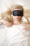 Beautiful young woman sleeping with eye mask Royalty Free Stock Photo