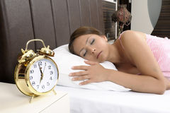 Beautiful young woman sleeping peacefully on bed Royalty Free Stock Photo
