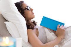 Beautiful young woman sleeping after read a book. Stock Image