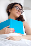 Beautiful young woman sleeping after read a book. Stock Images