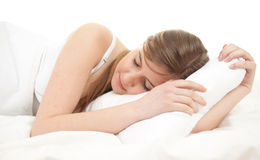 Beautiful young woman sleeping in white bedding Stock Images