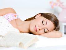 Beautiful young woman sleeps stock photo
