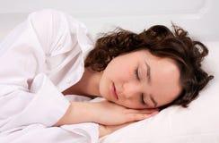 Beautiful young woman sleeps Stock Photos
