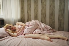 Beautiful young woman sleeps in the bedroom Stock Photo
