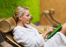 Beautiful young woman with smartphone at spa Royalty Free Stock Photos