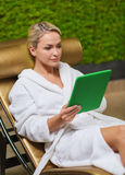 Beautiful young woman with smartphone at spa Stock Photography