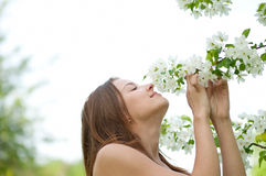 Beautiful young woman smelling Stock Photo