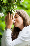 Beautiful young woman smelling Royalty Free Stock Photography