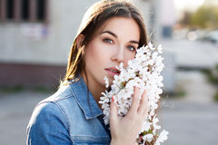 Beautiful young woman smelling cherry blossom Royalty Free Stock Photos