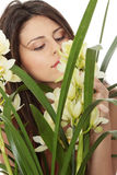 Beautiful young woman smelling orchid flower Royalty Free Stock Photos