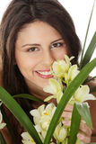 Beautiful young woman smelling orchid flower Stock Photography