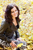 Beautiful young woman smiling. Portrait of the young beautiful smiling woman outdoors stock images