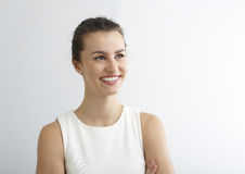 Beautiful young woman smiling against white background. Royalty Free Stock Photo