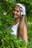 Beautiful young woman smiling in apple tree garden Stock Photography
