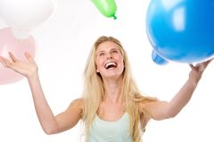 Beautiful young woman smiling with balloons Royalty Free Stock Image