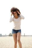Beautiful young woman smiling at the beach Stock Images