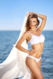Beautiful young woman smiling in bikini on the sea. Beautiful young woman in bikini on the sea stock photos