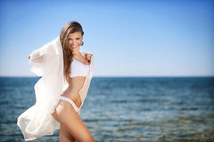 Beautiful young woman smiling in bikini on the sea. Beautiful young woman in bikini on the sea stock image