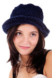 Beautiful young woman smiling,with blue hat Royalty Free Stock Photography