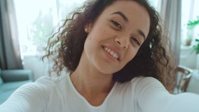 Beautiful young woman smiling at the camera in bright apartment. stock video footage