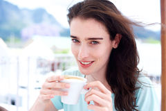 Beautiful young woman smiling with coffee cup Royalty Free Stock Image