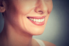 Beautiful young woman smiling. Dental health. Cropped image of a beautiful young woman smiling. Dental health royalty free stock photography