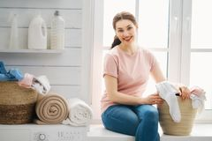 Woman is doing laundry royalty free stock photos