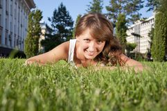 Beautiful young woman smiling in a field Stock Photography