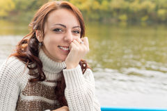 Beautiful young woman smiling happily Royalty Free Stock Photo