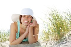 Beautiful young woman smiling with hat Stock Photo