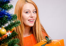 Beautiful young woman smiling holding Christmas presents. Royalty Free Stock Photography