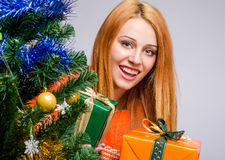 Beautiful young woman smiling holding Christmas presents. Stock Image