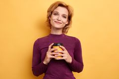 Beautiful young woman smiling , holding takeaway coffee stock image