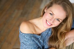 Beautiful young woman smiling at home Royalty Free Stock Photo