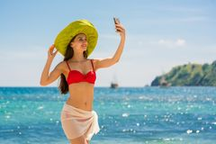 Beautiful young woman smiling while making a selfie in Flores Is stock photos