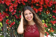 Beautiful young woman smiling outdoors in Spring / Summer time w royalty free stock image