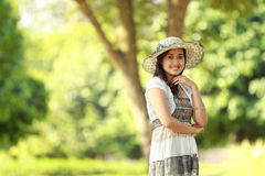 Beautiful young woman smiling in a park Royalty Free Stock Images