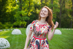Beautiful young woman smiling portrait on nature, the joy of life, smile Royalty Free Stock Images