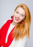 Beautiful young woman smiling with red balls earrings. Stock Photography