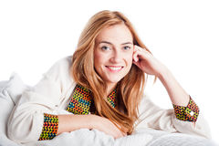 Beautiful young woman smiling and relaxing on a sofa Royalty Free Stock Images