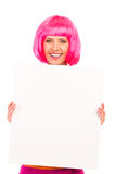 Beautiful young woman smiling and showing a blank white board. Stock Images