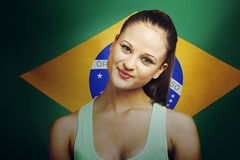 Beautiful Young woman smiling standing in front of Brazilian flag Stock Images