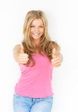Beautiful young woman smiling with thumbs up Royalty Free Stock Image
