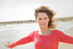 Beautiful young woman smiling on a windy day. At the seaside Royalty Free Stock Photography